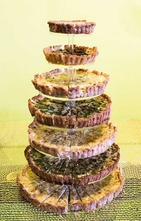Seven tiers of two different quiches served at spring-forward brunch 2013